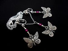 A TIBETAN SILVER BUTTERFLY/PURPLE BEAD NECKLACE AND CLIP ON EARRING SET. NEW.