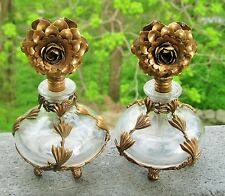 VICTORIAN PAIR OF GLASS FOOTED PERFUME BOTTLES FLORAL BRASS OVERLAY FLOWER STOPP