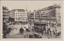 MADRID, SPAIN. PUERTA DEL SOL.  BUSY STREET WITH OLD CARS. REAL PHOTO POSTCARD