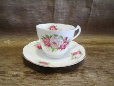 Rose pattern tea cup and saucer fine bone china made in England Crown Mark