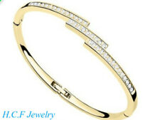 18K GOLD PLATED DESIGN BANGLE MADE WITH CLEAR SWAROVSKI CRYSTALS OPENABLE CLASP
