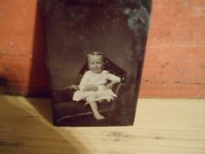 ANTIQUE VINTAGE TINTYPE PHOTO OF SMALL CHILD ON A STUDIO COUCH - CIRCA 1810
