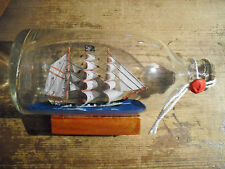 """Pirate ship with full sails in a glass bottle 7"""" long  x 3 1/2"""" high"""