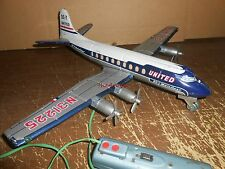Vintage United airlines DC 7 Battery Operated Tin Toy Jet Airplane Japan