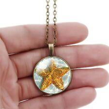 bisuteria y complementos collar bronce colgante redondo estrella de mar agua