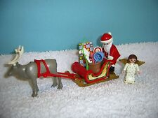PM Weihnachten:  Renntier Schlitten mit Weihnachtmann + Christkind + Geschenke
