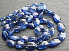 "HAND FACETED MIDNIGHT BLUE KYANITE OVALS, 4x6mm - 8x12mm, 16.5"", 52 beads"