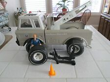 Tonka Chevron tow truck with driver , jack, spare tire and pylon