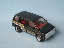 Matchbox Dodge Caravan Black Body with Gold and Silver Stripes UB