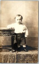 Vintage RPPC Studio Real Photo Postcard Stunned Baby Boy w/ Hand on Table c1910s