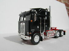DCP 1/64 SCALE KENWORTH K100 AERODYNE CABOVER BLACK WITH RED FRAME (TRACTOR ONLY