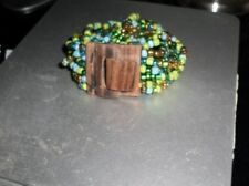 BEADED MULTI STRAND STRETCH BRACELET WOODEN CLASP