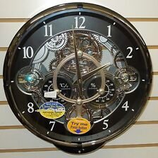 RHYTHM MUSICAL MAGIC MOTION  WALL CLOCK -30 MELODIES - FANCY ROTATING GEARS