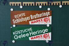 zwei Stück alte Werbeschilder Gelee Heringe Schlutuper Bratheringe