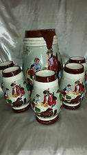 set of 5  Matching Ceramic Cups and Jug hunter and family