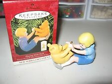 """HALLMARK KEEPSAKE ORNAMENT   """"PLAYING WITH POOH""""  DATED 1999"""