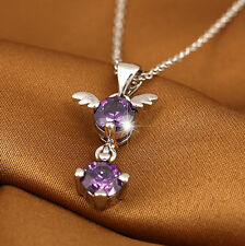 Silver tone angel wings with hanging purple crystal pendant necklace