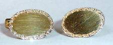 A SMALL VINTAGE PAIR OF OVAL GOLD ON SILVER T-BAR CUFFLINKS