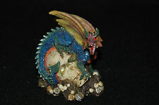 "Dragon Perched on Skull Figurine-- Poly Resin-- 3""L x 2""W x 3 1/4""H"