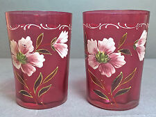 A Pair of Victorian Cranberry Glass Floral Enamel Decorated Tumblers