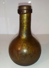A wonderful Rare 17th century iridescent amber/green onion bottle.