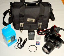 Canon Rebel XSi Digital camera and 18-55mm IS Canon lens and bag w Bundled items