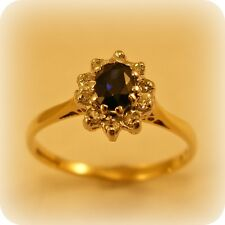 Oval Sapphire & Diamond 9 carat Gold Cluster Ring