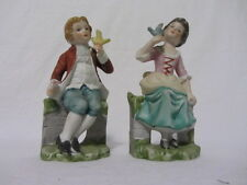 PORCELAIN BOY & GIRL HOLDING BIRDS SITTING ON FENCE COLLECTIBLE FIGURINES