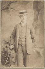 CABINET CARD. JOHNSTOWN PA. YOUNG MAN IN PIN STRIPE SUIT WEARING A FUNNY HAT.