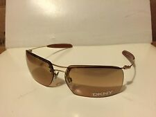 New DKNY 7252S (717) Shiny Gold  / Light Pink-Clear Gradient lens w/ Gold Flash