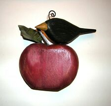 B. HUFFMAN 'BLACK BIRD ON RED APPLE' WOOD CARVING. SIGNED, DATED AND NUMBERED