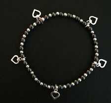 Sterling Silver And Hematite Beaded Stretch Bracelet With Silver Heart Charms.