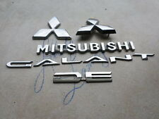 01-03 Mitsubishi Galant DE Grille Logo Mr971392 Liftgate Mr971393 Emblem Decals