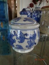 Early Oriental  Covered Jar with flower finale blue and creme some crazing lid