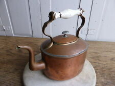 Antique copper kettle with china handle