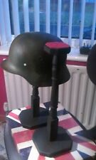 pair of german helmet and hat display stands,