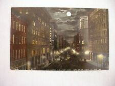 VINTAGE POSTCARD OF WASHINGTON AVE., WEST FROM 3RD ST. AT NIGHT IN ST. LOIUS, MO
