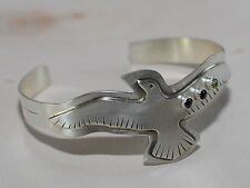 handmade bird bracelet in sterling with garnet and peridot