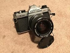 Pentax K1000 SE with Vivitar 35-70mm f/3.5-4.5 lens and 2800 Flash
