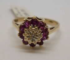 9ct Yellow gold round cut ruby & diamond flower ring with white gold detailing