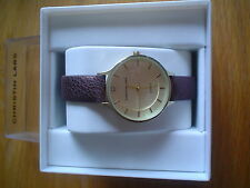 LADIES' GOLD WATCH ,CHRISTIN LARS, BRONZE LEATHER STRAP.