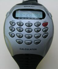 Vintage Men's Sharp calculator / alarm watch with date SHP5741 284 MS014