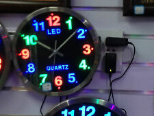 ROUND LED WALL CLOCK - LOOKS GOOD IN ANY ROOM - MULTICOLOURED - MAINS OPERATED