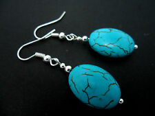 A PAIR OF SIMPLE OVAL TURQUOISE  SILVER PLATED DROP EARRINGS. NEW.