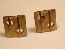 Reticulated brushed gold colored Shield brand cufflinks