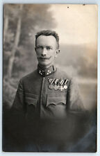 Antique WW1 GERMAN Real Photo RPPC Postcard HANDSOME OFFICER Soldier w/ 5 MEDALS