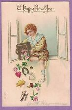 0117A NEW YEARS VTG PC VICTORIAN BOY  DUMPS BASKET FULL OF GOOD LUCK CHARMS