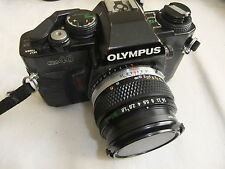 Camera OLYMPUS OM40 with ZUIKO 1:1.8 50mm lens   .. T14
