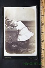 Antique Cabinet Card Photo Smiling Child with Head Resting on a Table