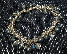 Lovely silver tone metal bracelet with many links and beads elasticated